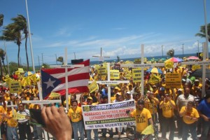 Electric utility workers of the UTIER labour union protest for safer workplace conditions. UTIER spearheads the fight against privatisation and against the Puerto Rico government's unpopular emergency economic measures. Courtesy of Photo Jam