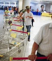 Customers line up to enter a state-run Bicentenario supermarket in Caracas, Venezuela. (Jorge Silva/Reuters)