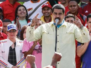 Venezuelan President Nicolas Maduro (C) delivers a speech during a rally in Caracas, Venezuela, on June 1, 2016.